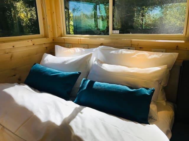 Super cozy queen bed.