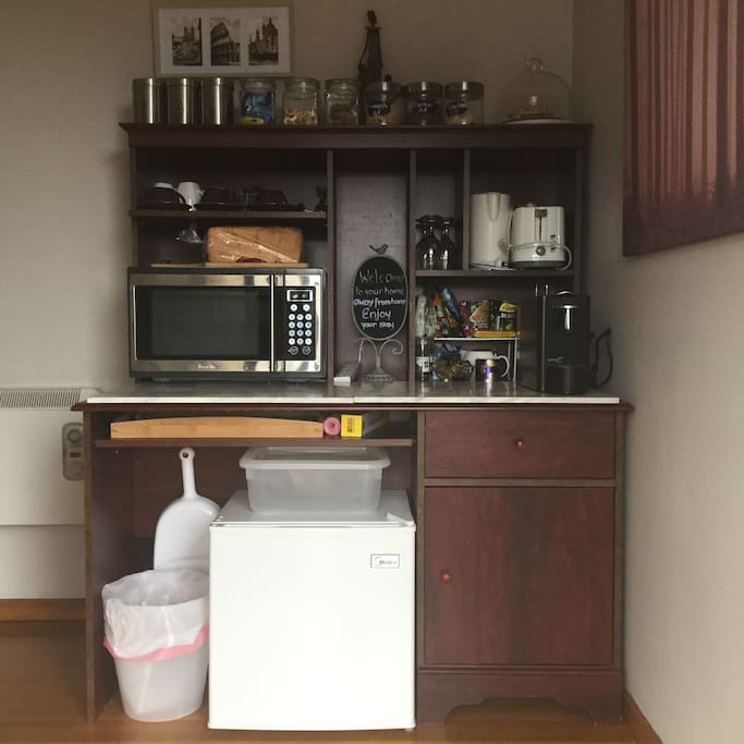 Kitchen nook, fridge, microwave, toaster, kettle, coffee machine & lots of tea, coffee, breakfast foods and snacks.