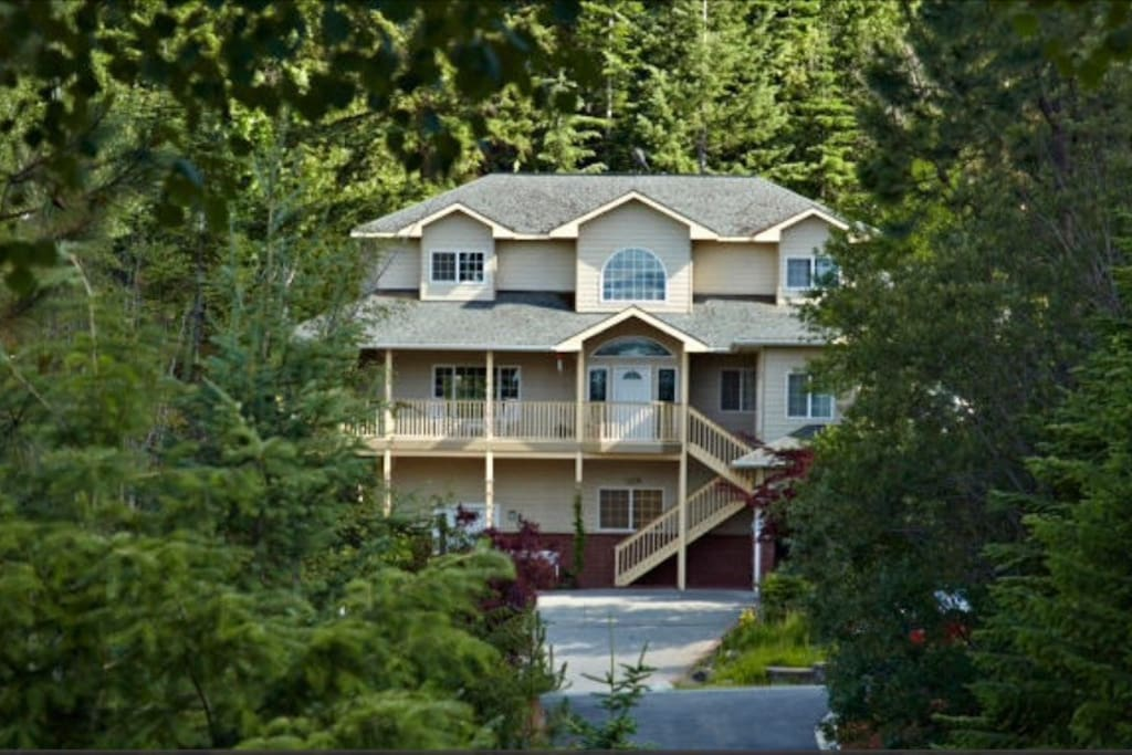 Beautiful home nestled in the mountains overlooking Hayden Lake.