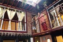 Smily Pramila in the walkway leading to the loft