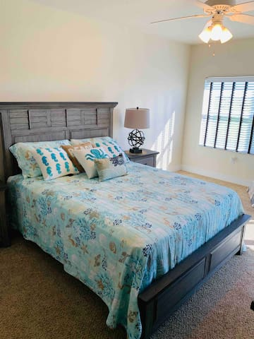 Master bedroom with access to back balcony and has access to master bathroom