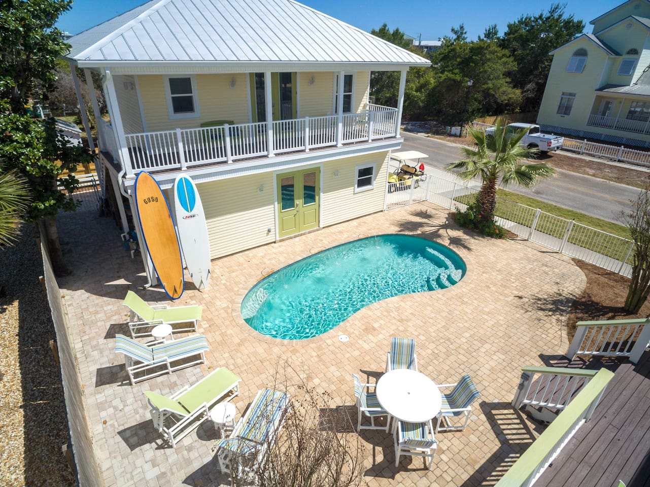 Carriage House above the garage.   Walk to the beach and swim in the pool!