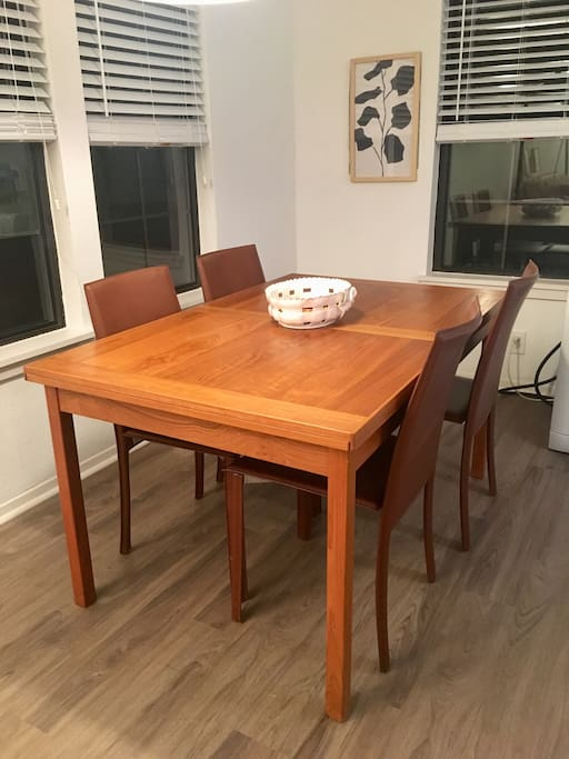 Dining room includes expandable table which can be extended to seat 10