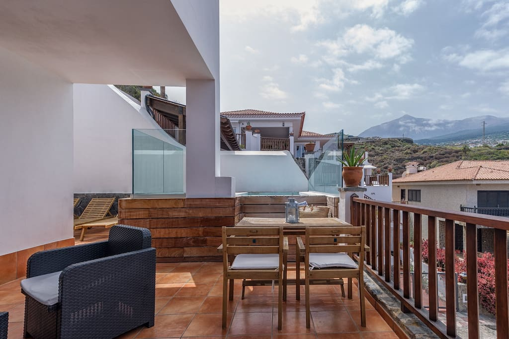 Nested on a hillside between the base of the volcano and the ocean your apartment and terrace offers one of the most stunning view of the whole island: the green north coast with its spectacular sunsets and the massive volcano Teide on the other side