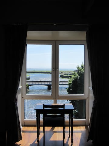 Sitting Room, Suspended over the River Corrib, with a Panoramic View of Galway Bay and the River. A Perfect Place to Enjoy a Cup of Coffee and Watch Galway Life Unfold.