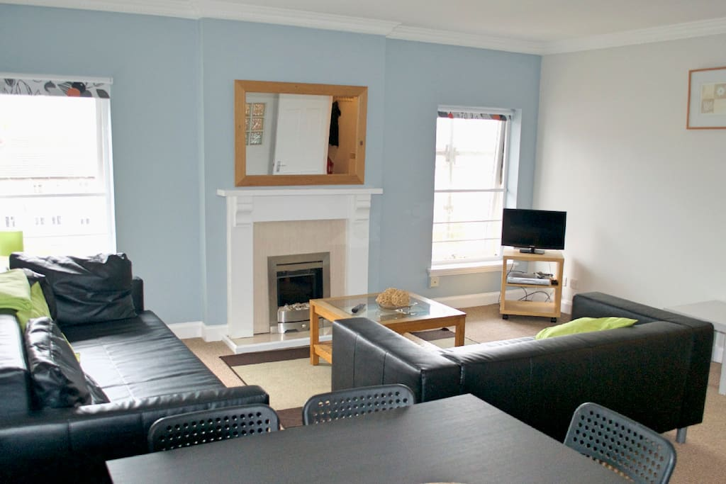 Bright living room with seating and dining area