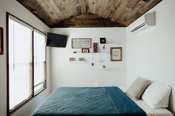 The Cedar room with queen bed and private bathroom.