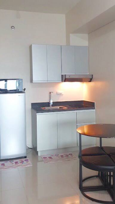 Fully furnished unit with proper appliances.