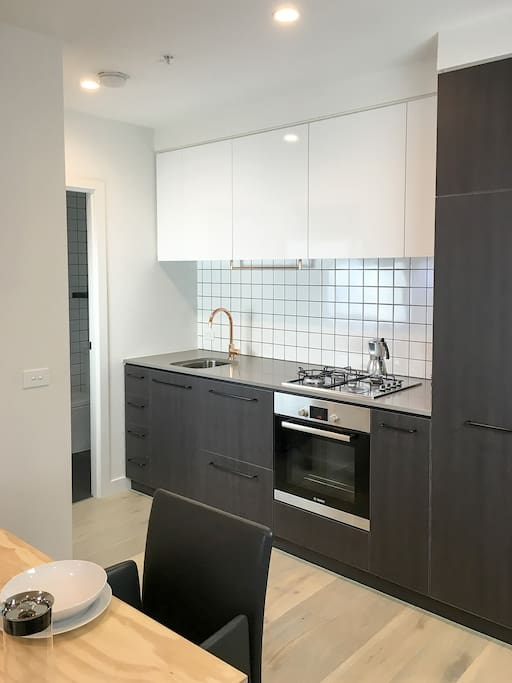 Fully functional kitchen including dishwasher and espresso maker.