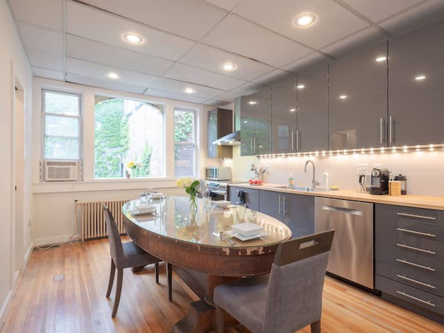 Kitchen was renovated in 2017 and features high end cabinets, pots, pans, dishes and everything you might need for a quick meal! Large kitchen table can seat four!