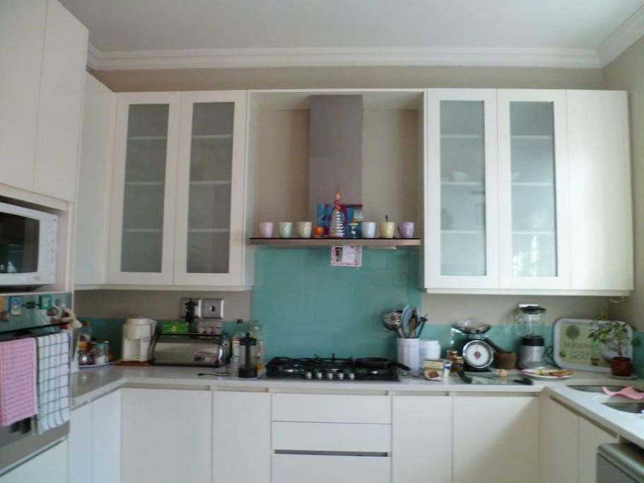 Modern Kitchen with gas hob and oven, microwave, Nespresso coffee machine and juice extractor+blender