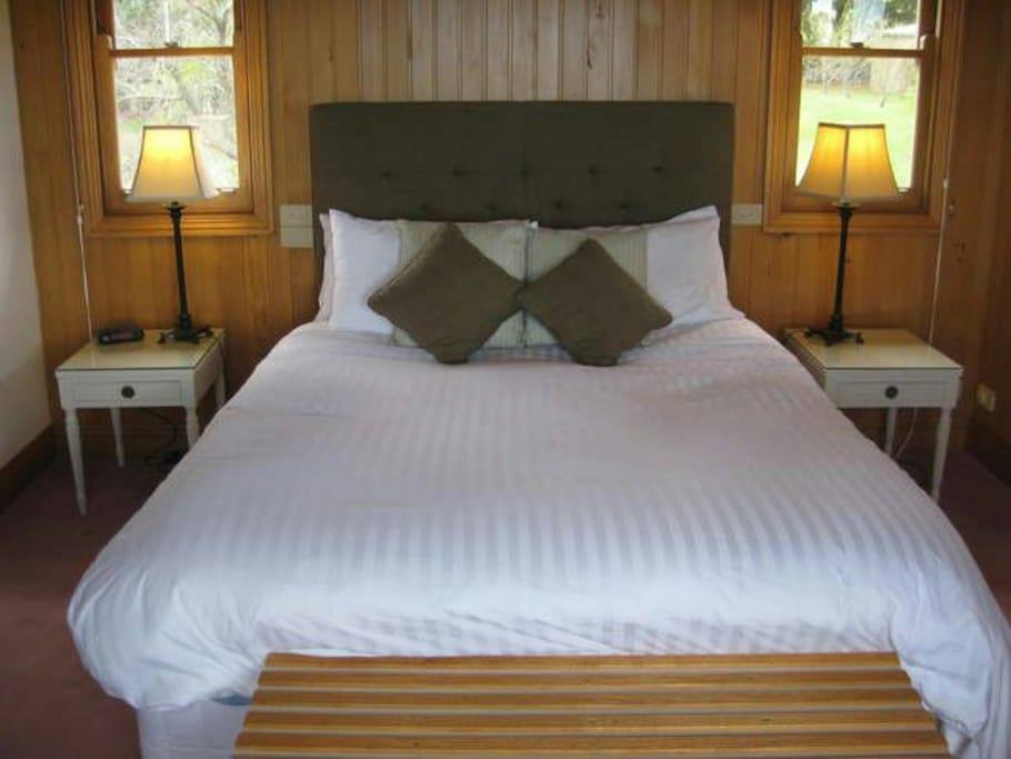 Upstairs queen bedroom with ensuite and walk in robe