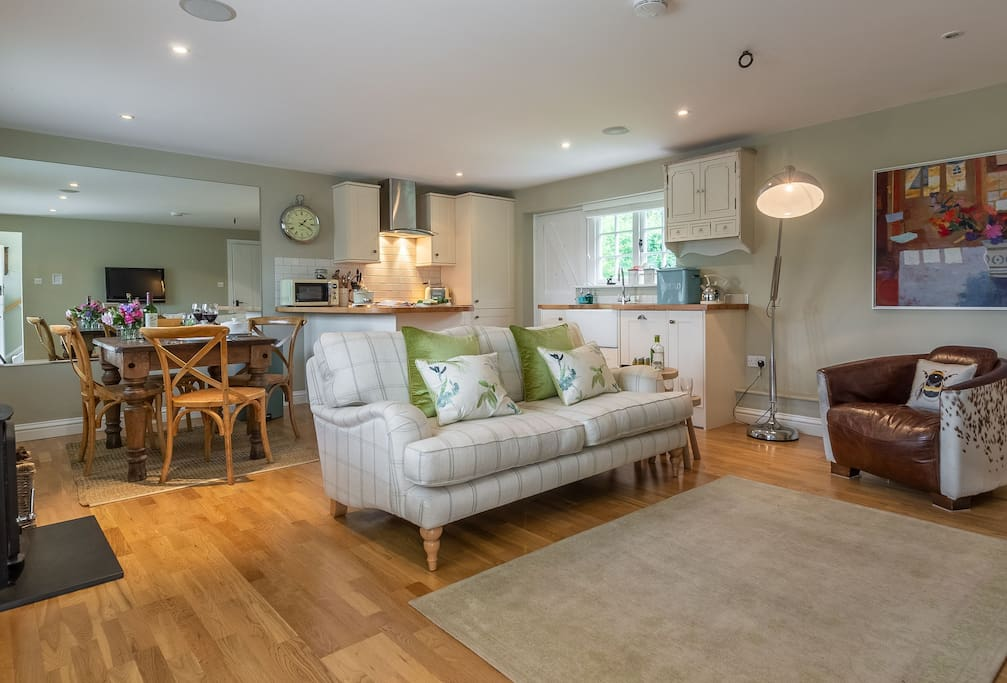 Ground floor:  Open plan kitchen, dining & sitting room with wood burning stove