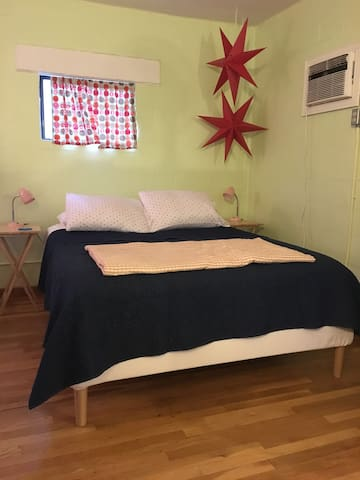 There is a queen-size bed, plus an extra queen-size air mattress for extra guests!