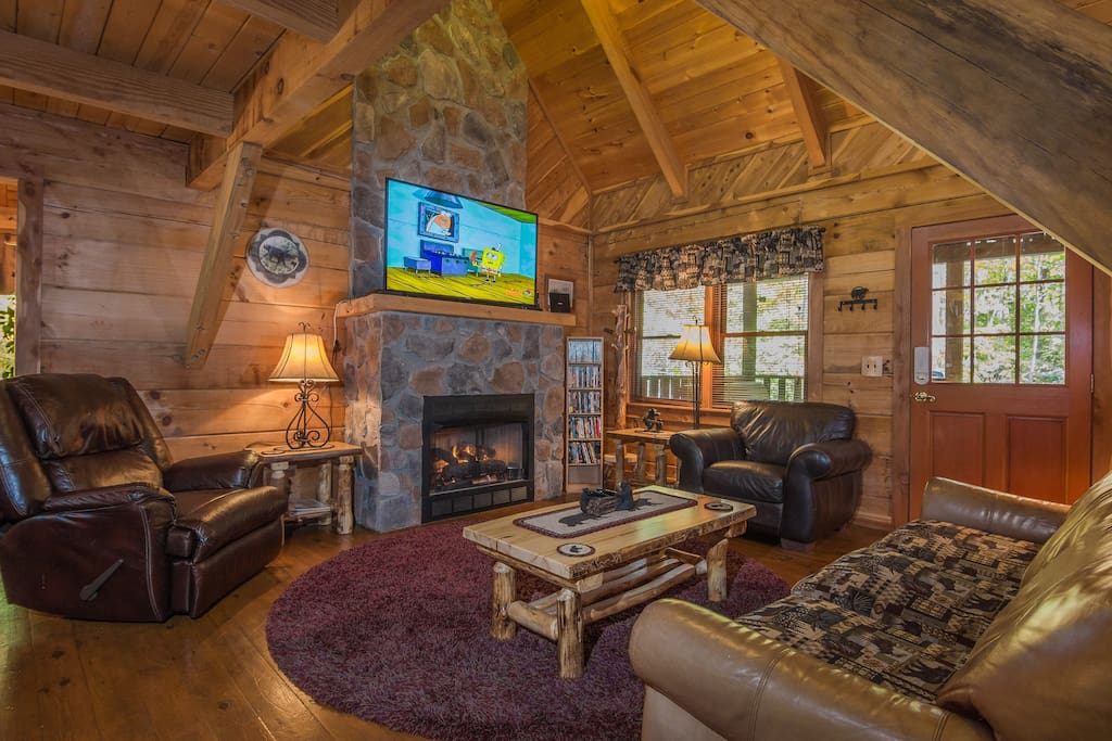 "Spacious Living Room, 52"" TV (Direct TV With The NFL Sunday Ticket Channel), A Great DVD Library Of Assorted Movies, A Leather Sofa Bed, 2 Comfy Leather Chairs, One Of Which Reclines, & Beautiful Log Furniture."