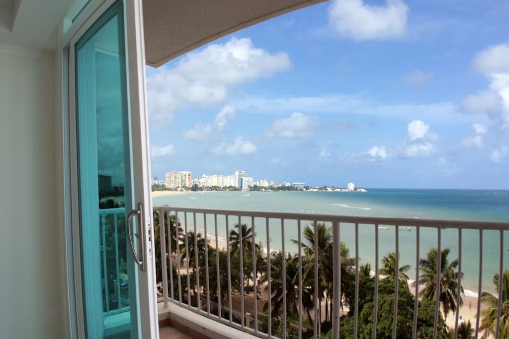 View from inside the apartment of the balcony & ocean.
