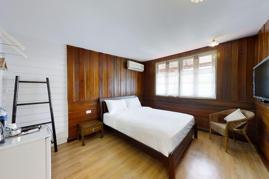 The Upper Deck bedroom with amenities and private bathroom