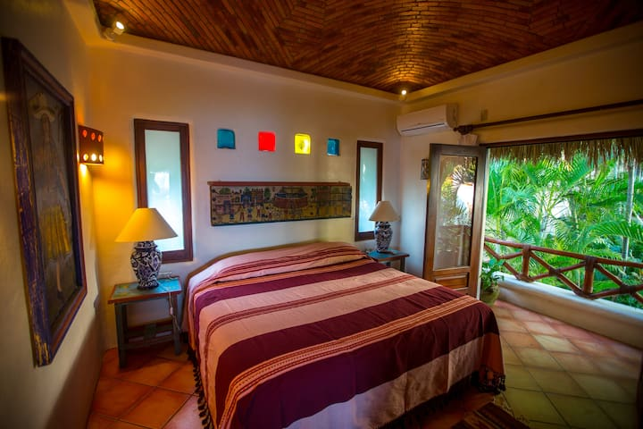 The upstairs bedroom/bathroom suite  in Casa Sofia, with a king size bed.