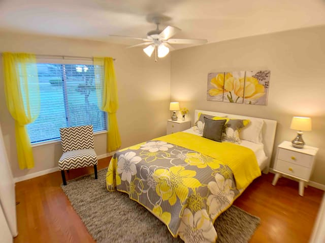 """The """"sunshine room"""" has a new comfy bed & mattress! Watch the deer graze on the grassy area out the pretty picture window.  Wake up happy every day!  No more than 4 guests allowed in this home. We like small groups because it keeps our place nice!"""