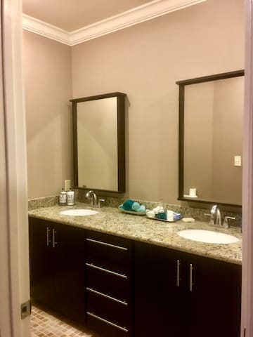 Double vanity bathroom with large shower and a bidet