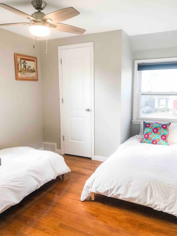 Twin bedroom with 2 single beds. Bed frames can also be stacked to make one taller bed. 100% cotton bedding. Adjustable speed ceiling fan. Room-darkening shade. Closet. Located on 2nd floor.