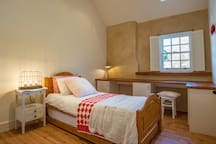 Bedroom 2 has single bed or twin beds depending upon occupancy.  This bedroom also has a useful desk for work related clients.