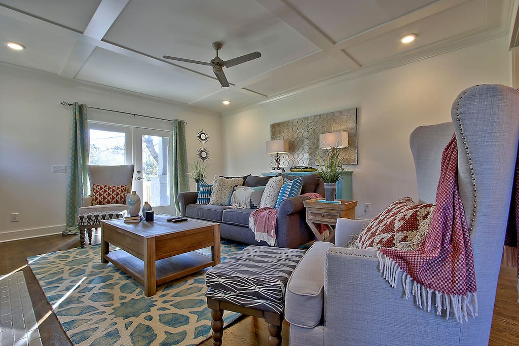Elegant appointments make the living room both cozy and attractive.