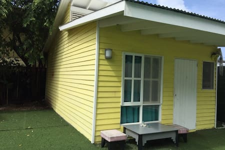 One bedroom yellow house