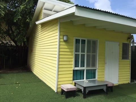 One bedroom yellow house