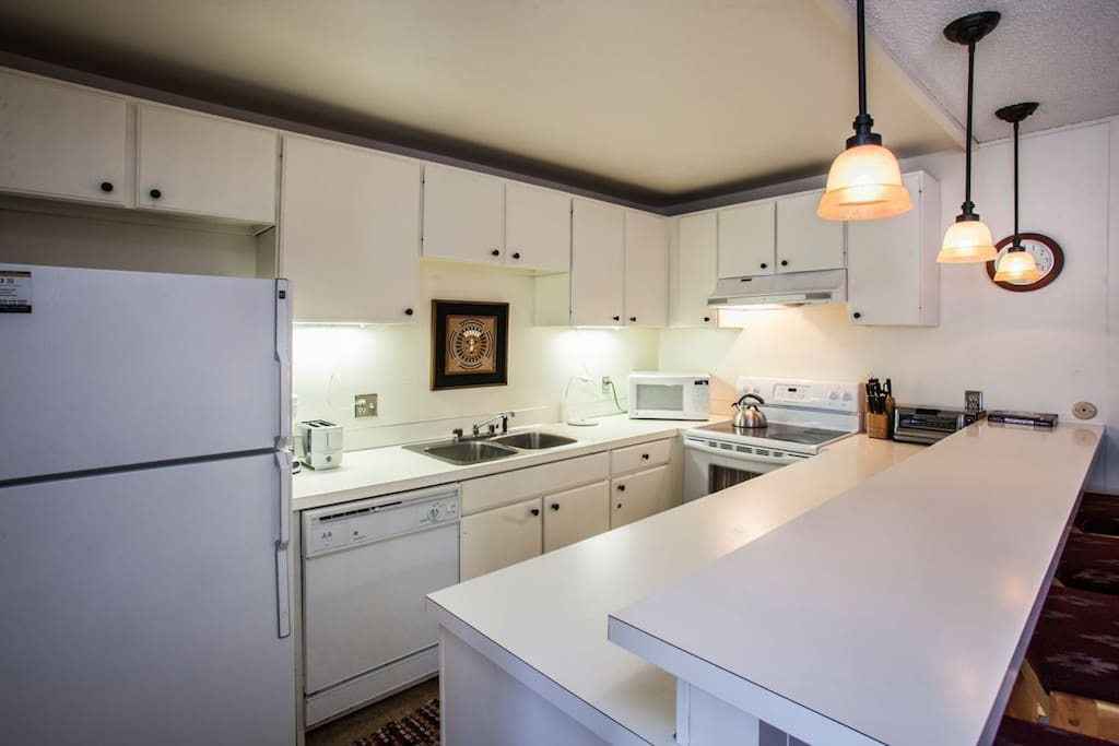 Spacious fully equipped kitchen, featuring Keurig and drip coffee makers and many more kitchen essentials.