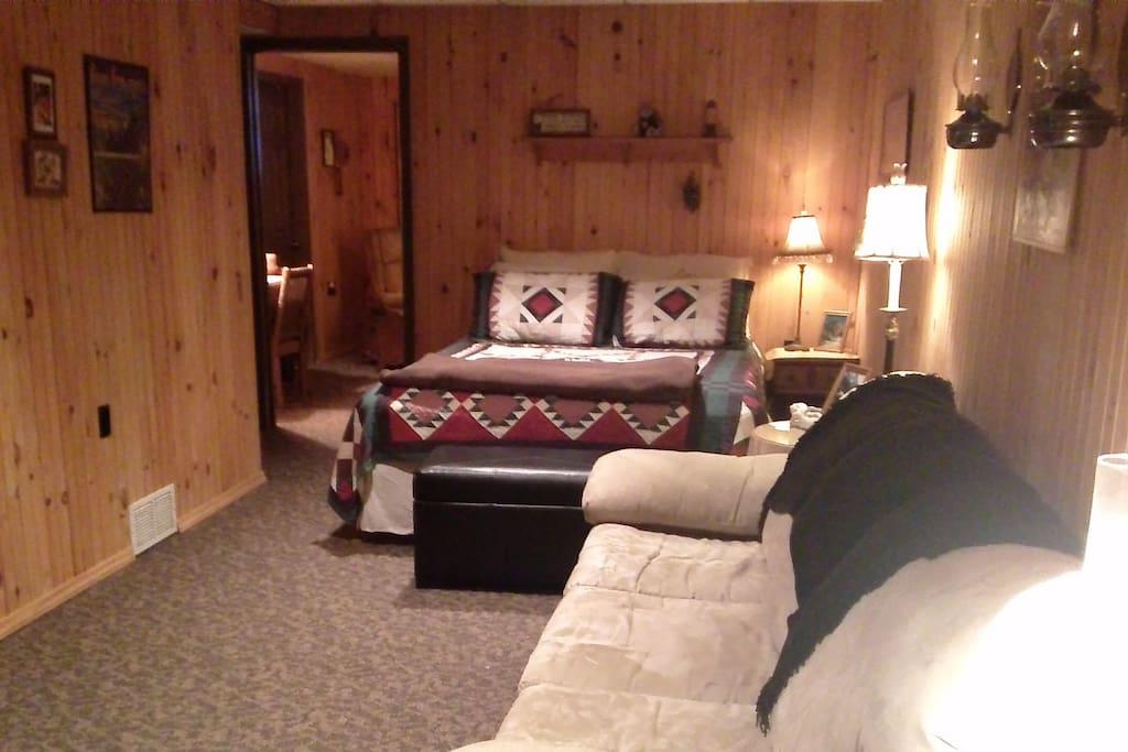 The sleeping area of Bedroom 1--a queen bed.