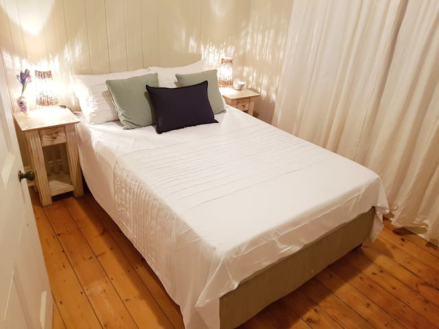 Double bed with bedside tables.