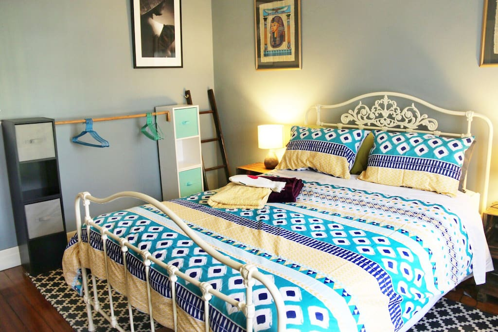 Large private bedroom provides ample storage space for clothes and luggage.