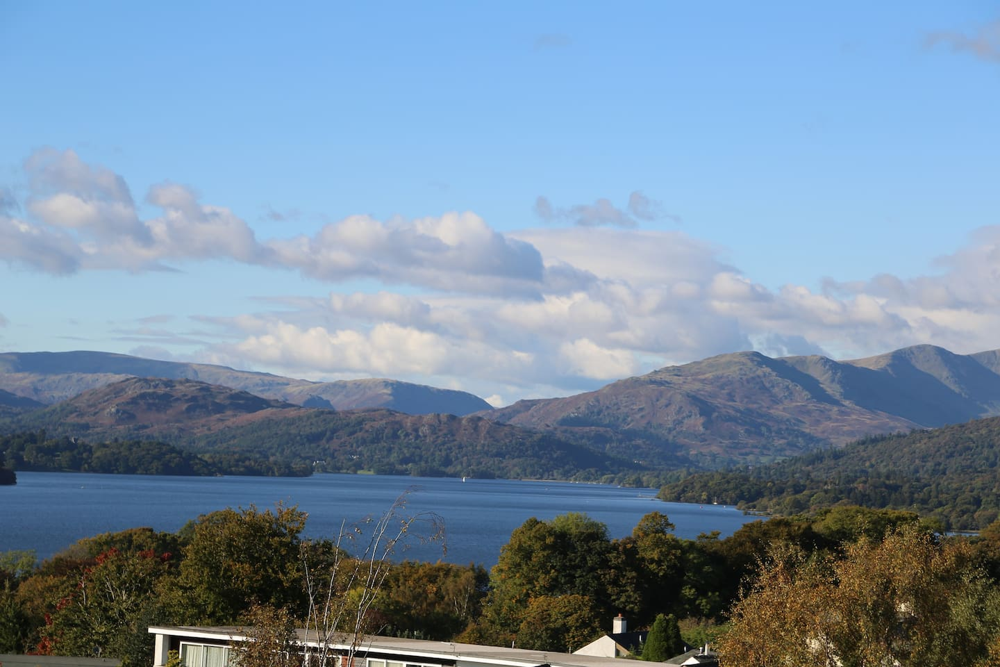 Panoramic views from the living and bedroom windows across Lake Windermere to the fells