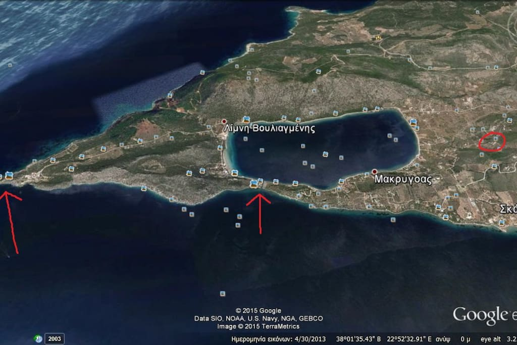 The first arrow shows the area of the ancient ruins, the second one show's the opening of the formed lake to the sea, and the circle shows the exact spot of the house