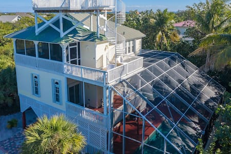 Manatee Haven: Upscale Beach View Home with Screened-in Pool, Spa & Elevator!