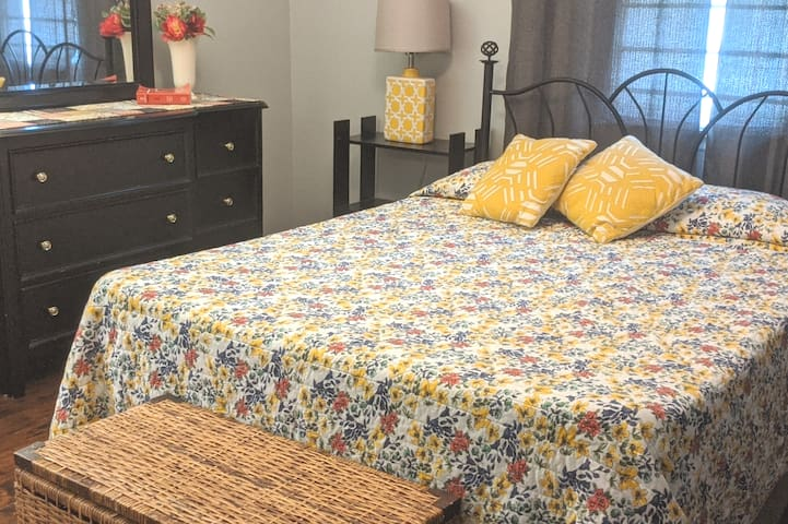 Master bedroom, has a memory foam queen size bed, fresh clean linens,a dresser,  large closet, ceiling fan, sitting chairs, table for luggage.