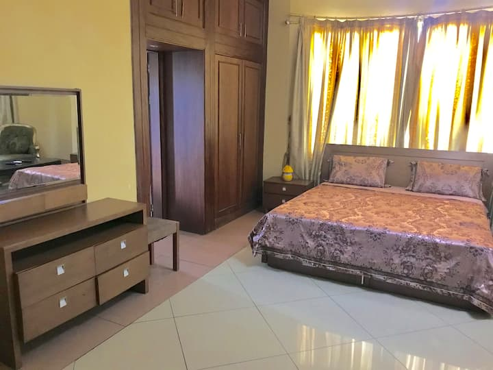 Double room with king bed in center of Kinshasa