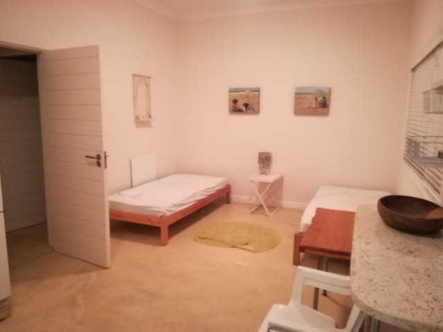 open plan with single bed and kitchenette