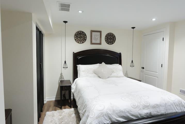 Cozy bedroom with queen bed, .....