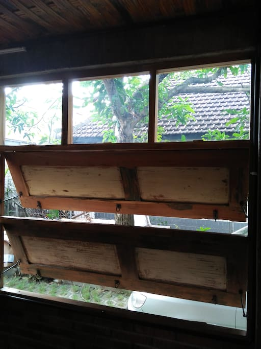 one of many old wooden windows to give you breeze to cool the room