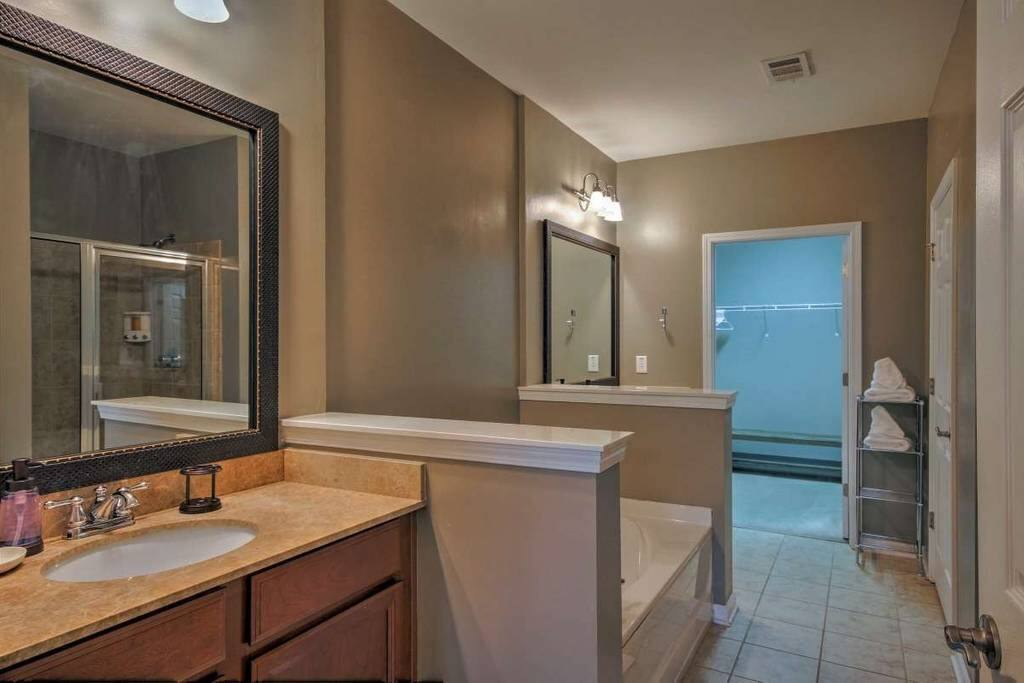 Spacious Master En-suite bathroom. boasts dual sinks, Jacuzzi tub and separate shower