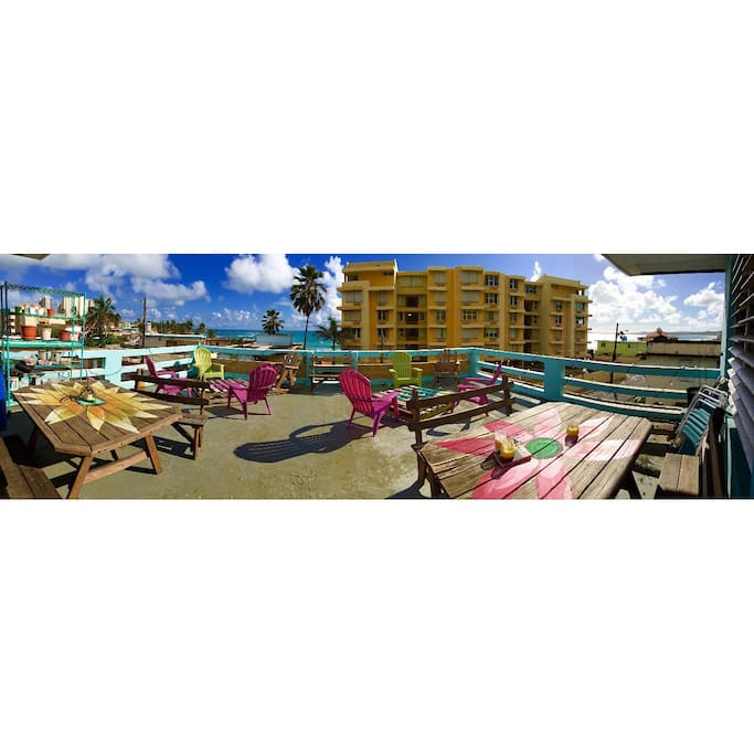 Colorful roof patio, with lots of seating and two picnic tables to eat any meal or just relax.