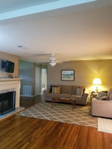 Open concept living room/kitchen/dining area with flat screen TV/DVD planner combo.