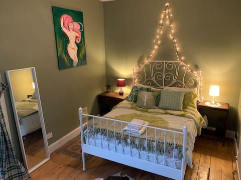 Cosy tropical bedroom in a bohemian seaside flat