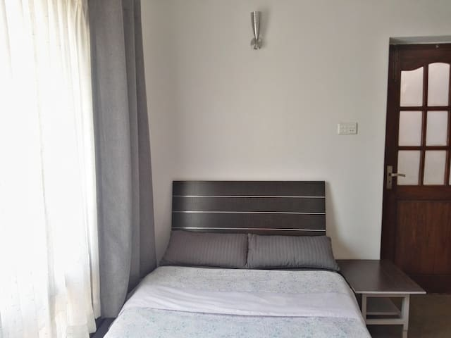 Double bed with balcony for work and leisure