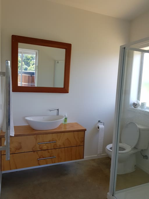 Two bathrooms - one main and one en-suite, both with shower