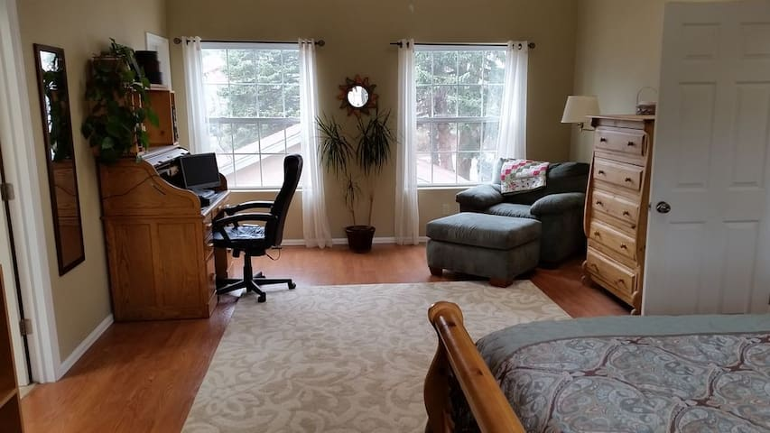 The master bedroom is very large, with skylights and a sitting area, all upstairs.