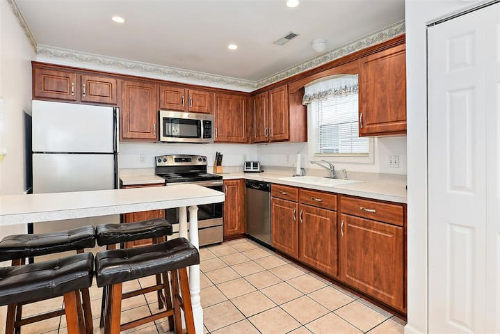 Just steps to the boardwalk from this 3 bedroom town home