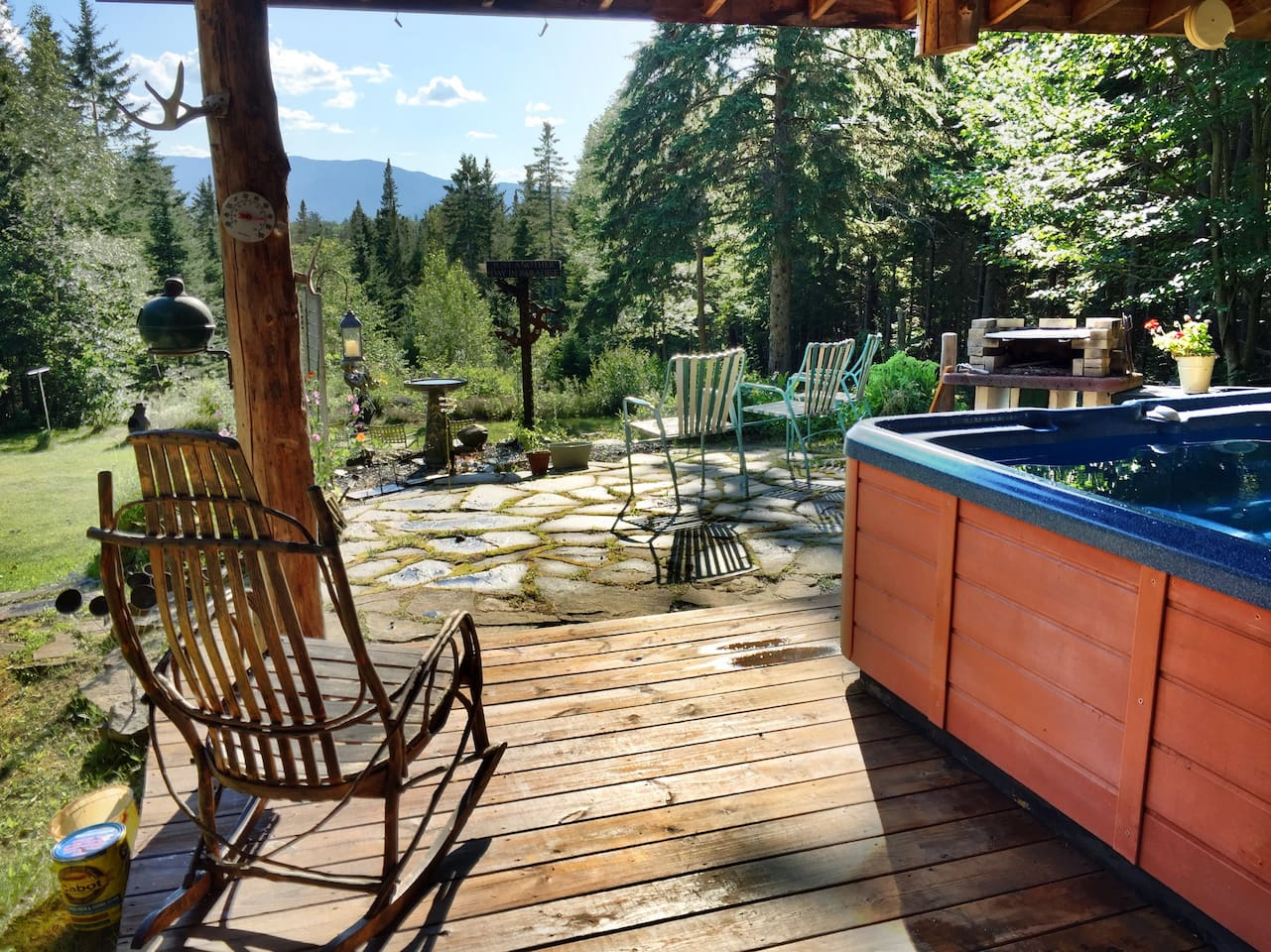 Hot tub deck and patio overlooking the back yard, gardens and view to the West